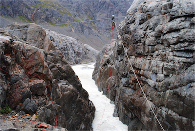 06 At 11am we reach the tyrolean rope over a churning bubbling channel of glaciated water that slices deep through the bed rock.